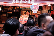 """A merchant of """"Maguro"""" or Tuna present his products to customers at the Ameyoko market, Ueno in Tokyo Sunday, Dec. 31, 2017. Ameyoko market is crowded by shoppers who look for discounts on ingredients for """"osechi"""" or Japanese traditional New Year dishes. 31/12/2017-Tokyo, JAPAN"""