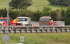 Auckland-Truck and trailer crashes through barrier, Bombay