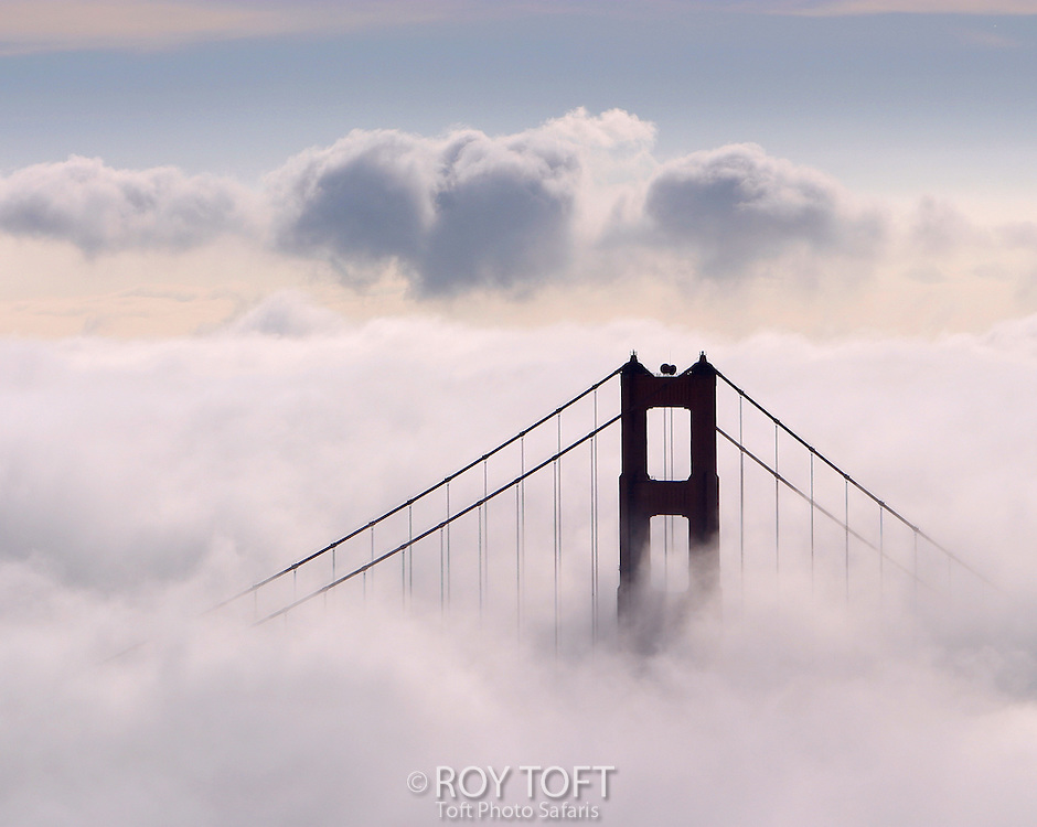 Close-up view of San Francisco's Golden Gate Bridge shrouded in fog.