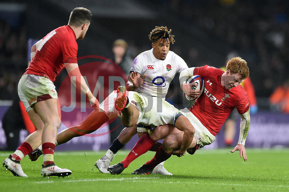 Rhys Patchell of Wales is tackled to ground - Mandatory byline: Patrick Khachfe/JMP - 07966 386802 - 10/02/2018 - RUGBY UNION - Twickenham Stadium - London, England - England v Wales - Natwest Six Nations