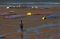 KNOKKE, BELGIUM - JULY-30-2005 -  A windsurfer makes his way back to dry land at Surfers Paradise in Knokke.  (Photo © Jock Fistick)