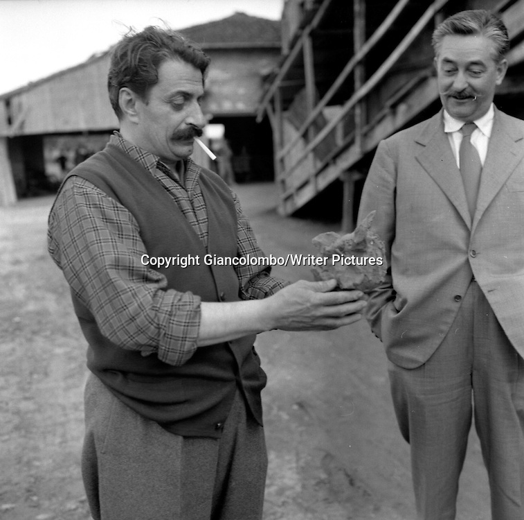 Giovannino Guareschi at his farm. Roncole (Parma)<br /> 1954<br /> <br /> Photograph by Giancolombo/Writer Pictures<br /> <br /> WORLD RIGHTS, NO AGENCY, NO ITALY