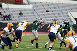 18 October 2014:  Greg Ferguson attempts to block a pass by Donovan Laible (QB) during an NCAA division 3 football game between the Augustana Vikings and the Illinois Wesleyan Titans in Tucci Stadium on Wilder Field, Bloomington IL
