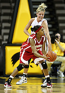 19 February 2009: Wisconsin guard Teah Gant (13) is defended by Iowa guard/forward Hannah Draxten (31) during the first half of an NCAA women's college basketball game Thursday, February 19, 2009, at Carver-Hawkeye Arena in Iowa City, Iowa. Iowa defeated Wisconsin 72-65.