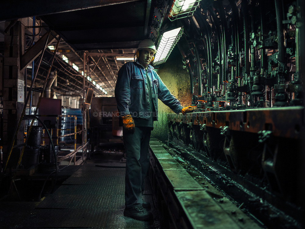 Carlos, 39, glass worker and trade unionist at Envidrio (Cristaleria del Uruguay). <br /> <br /> After a long struggle, the help of Ugo Chavez and Pepe Mujica, workers from &quot;Cristaler&iacute;as del Uruguay&quot; have set up their own business, have took over control of the factory in which they had worked before bankruptcy, and have constituted the only factory of glass bottles in the country: Envidrio. The plant produces about 180,000 bottles a day and exports them in Argentina, Venezuela and Brazil.<br /> Inspired by &quot;f&aacute;bricas recuperadas movement&quot;, Envidrio emerges in response to Argentine's 2001 economic crisis and now it's the most significant &quot;workers' self-management&quot; phenomenon in Uruguay.<br /> Uruguay, Feb. 2014