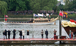 © Licensed to London News Pictures. 03/06/2012. London, UK. Royal Barge Gloriana making its way up the River Thames past the Royal Barge Spirit of Chartwell during the Jubilee Pageant on the River Thames, London on June 03,2012 as part of The Diamond Jubilee celebrations. Great Britain is celebrating the 60th  anniversary of the countries Monarch HRH Queen Elizabeth II accession to the throne . Photo credit : Ben Cawthra/LNP