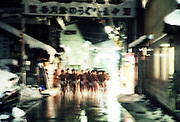 "Men dressed in only a ""fundoshi"" cloth thong run through the snowy streets during the Hadaka Mairi in Yanaizu, Fukushima Prefecture, Japan. The winter ritual, variations of which exist throughout Japan, is undertaken by males alone as a purification ritual. It has its origins in an ancient folk legend, in which the people of Yanaizu underwent a quest to drive away the Dragon God, who lived in the Tadami River, which flows through the town, and who had entered the town in order to steal the treasure of Enzoji Temple, where the main event of the Hadaka Mairi is held. It has been an annual tradition for more than a thousand years."