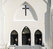 Members of the Charleston County Sheriff's Office guard the front doors of the Emanuel A.M.E. Church during a worship service four days after a mass shooting that claimed the lives of it's pastor and eight others, Sunday, June 21, 2015, in Charleston, S.C. (AP Photo/Stephen B. Morton)