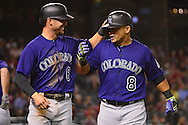 Apr 29, 2016; Phoenix, AZ, USA; Colorado Rockies outfielders Ryan Raburn (6) and Gerardo Parra (8) react after scoring during the eighth inning against the Arizona Diamondbacks at Chase Field. Mandatory Credit: Jennifer Stewart-USA TODAY Sports