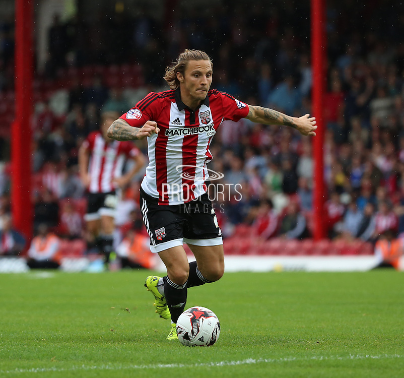 Sam Saunders (Brentford midfielder) driving into the Brentford box during the Sky Bet Championship match between Brentford and Reading at Griffin Park, London, England on 29 August 2015. Photo by Matthew Redman.