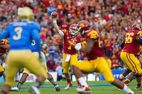 17 October 2012: Quarterback (7) Matt Barkley of the USC Trojans passes the ball against the UCLA Bruins during the first half of UCLA's 38-28 victory over USC at the Rose Bowl in Pasadena, CA.