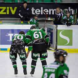 30.01.2015, Hala Tivoli, Ljubljana, SLO, EBEL, HDD Telemach Olimpija Ljubljana vs EC Red Bull Salzburg, 43. Runde, in picture Luka Kalan (HDD Telemach Olimpija, #61) and Gregor Koblar (HDD Telemach Olimpija, #20) during the Erste Bank Icehockey League 43. Round between HDD Telemach Olimpija Ljubljana and EC Red Bull Salzburg at the Hala Tivoli, Ljubljana, Slovenia on 2015/01/30. Photo by Morgan Kristan / Sportida