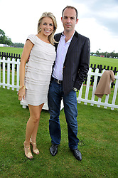 MARTIN LEWIS and his wife LARA LEWINGTON at the Cartier Queen's Cup Polo Final, Guards Polo Club, Windsor Great Park, Berkshire, on 17th June 2012.
