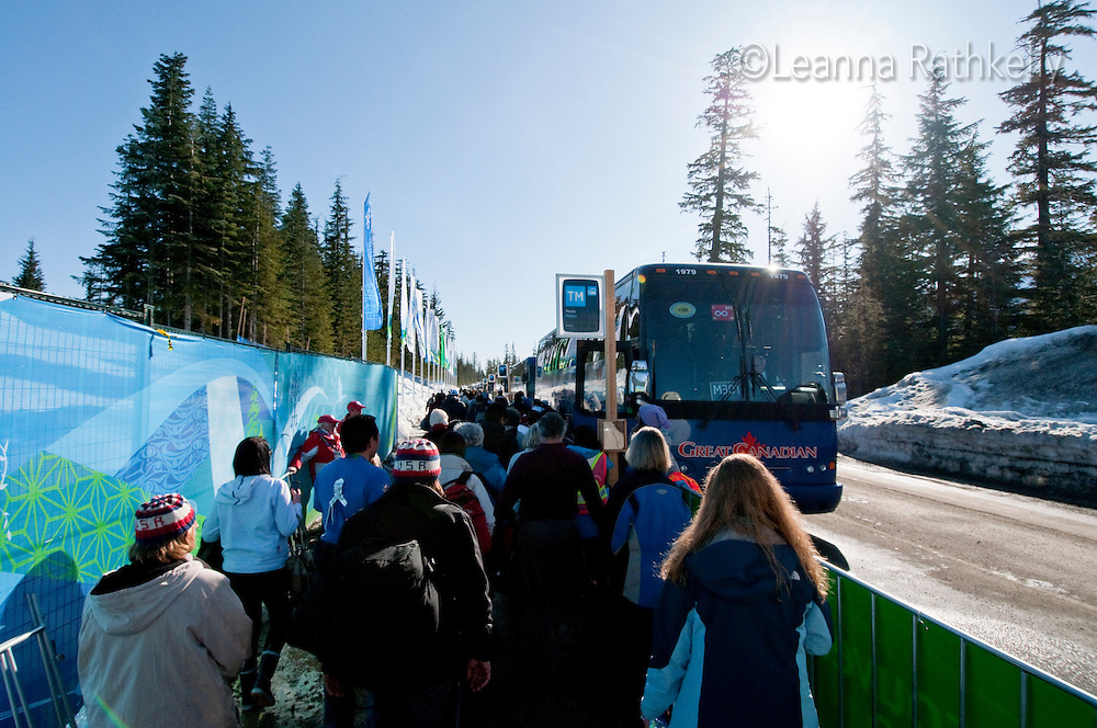 Spectators line up to leave Whistler Olympic Park after the ski jump competition during the 2010 Olympic Winter Games in Whistler, BC Canada.