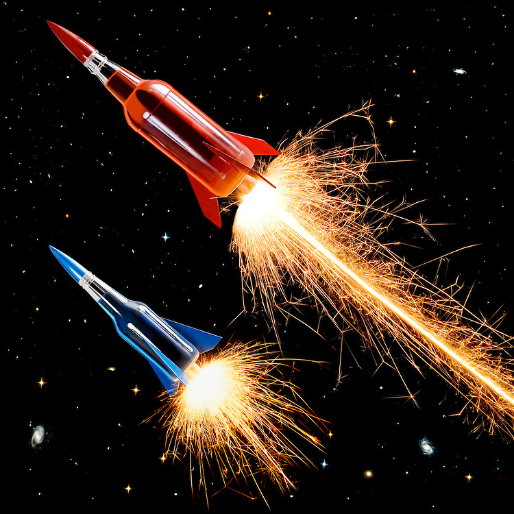 A Pair of Bottle Rockets Zoom Through Space