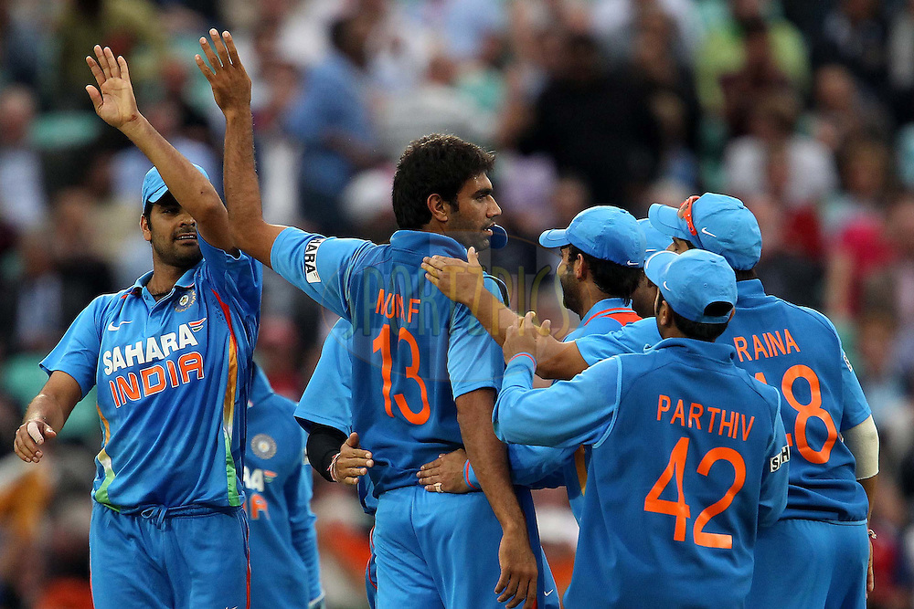 India's Munaf Patel celebrates the wicket of England's Alistair Cook during the 3rd One Day International ( ODI ) between England and India held at the Kia Oval in London, England on the 9th September 2011...Photo by Ron Gaunt/SPORTZPICS/BCCI