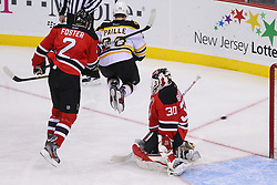 Jan 19; Newark, NJ, USA; Boston Bruins defenseman Andrew Ference (21) scores a goal through a screen by Boston Bruins left wing Daniel Paille (20) during the third period at the Prudential Center.   The Bruins defeated the Devils 4-1.