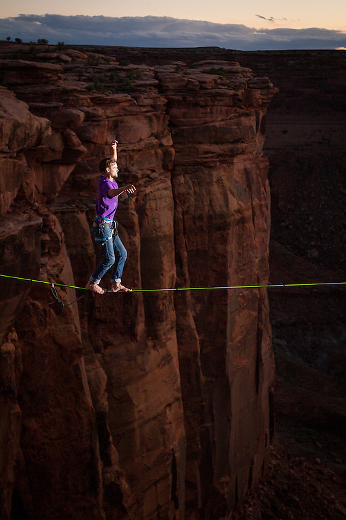 Sylvan Christensen walks with 300' of exposure at dusk.<br /> The Fruit Bowl, Utah.