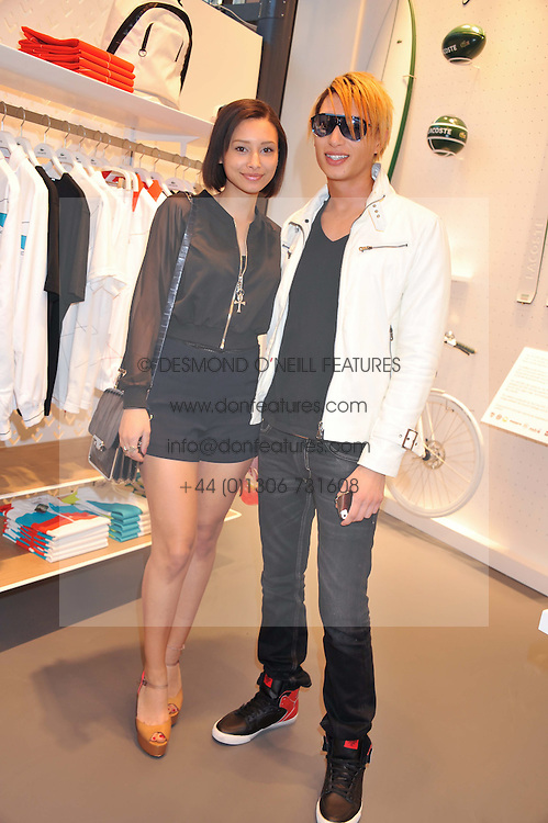 LEAH WELLER and NATT WELLER at a party to celebratethe opening of the Lacoste Flagship Store at 44 Brompton Road, Knightsbridge, London on 20th June 2012.