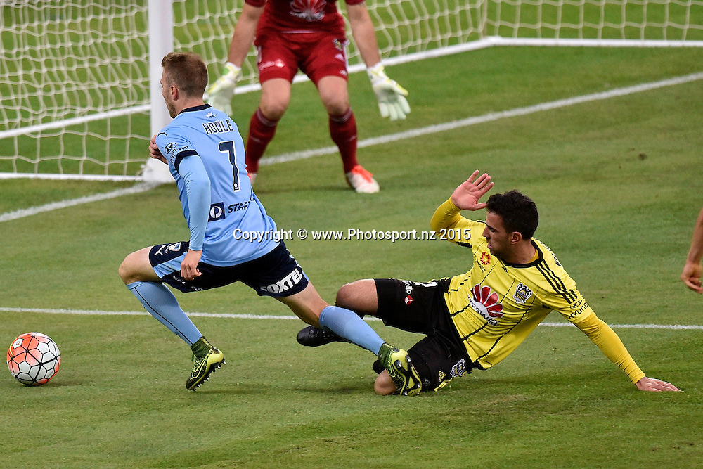 Andrew Hoole (L) of Sydney FC is tackled by Manny Muscat of the Phoenix during the A-League - Wellington Phoenix v Sydney FC football match at Westpac Stadium in Wellington on Sunday the 19th of December 2015. Copyright Photo by Marty Melville / www.Photosport.nz