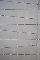 New York, New York City. Grey metal facade of a building.
