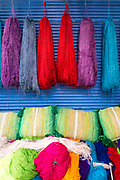 Colourful fabrics and materials hang to dry in the dyers souk (souk des tenturiers), Marrakech Medina, Morocco