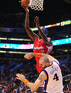 Apr. 1, 2011; Phoenix, AZ, USA; Los Angeles Clippers forward Al-Farouq Aminu (3) is fouled by the Phoenix Suns forward Marcin Gortat (4) at the US Airways Center. The Suns defeated the Clippers 111-98. Mandatory Credit: Jennifer Stewart-US PRESSWIRE