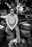"Billy Carter sits with a can of beer atop a pile of used tires at the rear of his gas station in Plains, Georgia. William Alton - Billy - Carter (March 29, 1937 – September 25, 1988) was an American farmer, businessman, brewer, and politician, and the younger brother of U.S. President Jimmy Carter. Carter promoted Billy Beer and was a candidate for mayor of Plains, Georgia. Carter was born in Plains, Georgia, to James Earl Carter Sr. and Lillian Gordy Carter. He was named after his paternal grandfather and great-grandfather, William Carter Sr. and William Archibald Carter Jr. respectively. He attended Emory University in Atlanta but did not complete a degree. He served four years in the United States Marine Corps, then returned to Plains to work with his brother in the family business of growing peanuts. In 1955, at the age of 18, he married Sybil Spires (b. 1939), also of Plains. They were the parents of six children: Kim, Jana, William ""Buddy"" Carter IV, Marle, Mandy, and Earl, who was 12 years old when his father died."