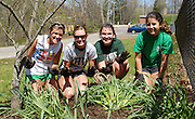 Ohio Club Field Hockey players, Sarah Whisman, Martha Blaney, Taylor Gaspar, and Maria Gallucci, pose for a photo after finishing up an Athens Beautification Day project at Highland Park.