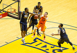 Oklahoma State Cowboys guard Phil Forte III (13) tries to pass against West Virginia during the second half at the WVU Coliseum.