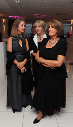 Left to right, SABRINA GUINNESS, ANNABEL ELLIOT and LADY ANNABEL GOLDSMITH at The Reuben Foundation and Virgin Unite Haiti Fundraising dinner held at Altitude 360 in Millbank Tower, London on 26th May 2010.