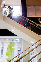 4 October, 2008. Customers go up the stairs of the Gap store of Times Square. As the financial crisis spread last month, many retailers hit the panic button, offering more generous discounts than they did at the same time last year. But the promotions did little to convince cautious shoppers to open their wallets.<br /> <br /> ©2008 Gianni Cipriano for The Wall Street Journal<br /> cell. +1 646 465 2168 (USA)<br /> cell. +1 328 567 7923 (Italy)<br /> gianni@giannicipriano.com<br /> www.giannicipriano.com