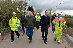 David Cameron meets workmen fixing potholes in Somerset.<br /> Day 3 of Prime Minister David Cameron's regional tour. <br /> Friday 4th of April 2014. Picture by Ben Stevens / i-Images