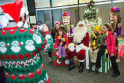 Families take photos with Santa Claus during the Christmas Tree Lighting Ceremony at the Milpitas City Hall's Civic Center in Milpitas, California, on November 30, 2015. (Stan Olszewski/SOSKIphoto)