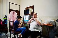 Napoli, Italia - 11 dicembre 2010. La signora Antonietta Sarnataro e suo figlio malato di asma all'interno della loro casa/stanza nell'albergo Vergilius di Napoli..Ph. Roberto Salomone Ag. Controluce.ITALY - Antonietta Sarnataro and her son in their room/house in Vergilius hotel in Naples on December 11, 2010.