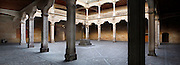 """Panoramic view of courtyard, Casa de las Conchas, Salamanca, Spain, pictured on December 17, 2010 in the afternoon. The Casa de la Conchas, 15th century, was built as the palace of Rodrigo Maldonado, a knight of the Santiago Order (Order of St James), whose emblem is a shell. Adorning the walls of the palace are carvings of shells, hence the name. It is now a library. Salamanca, an important Spanish University city, is known as La Ciudad Dorada (""""The golden city"""") because of the unique golden colour of its Renaissance sandstone buildings. Founded in 1218 its University is still one of the most important in Spain. Around it the Old Town is a UNESCO World Heritage Site. Picture by Manuel Cohen"""