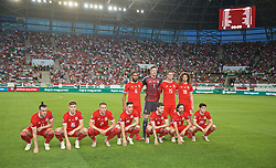 BUDAPEST, HUNGARY - Tuesday, June 11, 2019: Wales' players line-up for a team group photograph before the UEFA Euro 2020 Qualifying Group E match between Hungary and Wales at the Ferencváros Stadion. Back row L-R: captain Ashley Williams, goalkeeper Wayne Hennessey, James Lawrence, Ethan Ampadu. Front row L-R: Gareth Bale, David Brooks, Chris Gunter, Tom Lawrence, Ben Davies, Joe Allen, Daniel James. (Pic by David Rawcliffe/Propaganda)