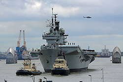 © Licensed to London News Pictures. File pic dated 08/05/2013. London, UK. HMS Illustrious coming through the Thames Barrier, heading  to Greenwich. The government has announced that HMS Illustrious is heading to the Philippines to help with the Typhoon Haiyan recovery efforts. Photo credit : Rob Powell/LNP