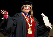 Clayton Spencer displays the symbols of office during her installation ceremony as the eighth president of Bates College on Friday, October 26, 2012. The symbols are the keys, the presidential collar, and the record book.