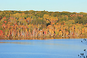 Fall colors paint the hillside adjacent to Portage Lake at Hancock, Michigan, in this image from October, 2009.
