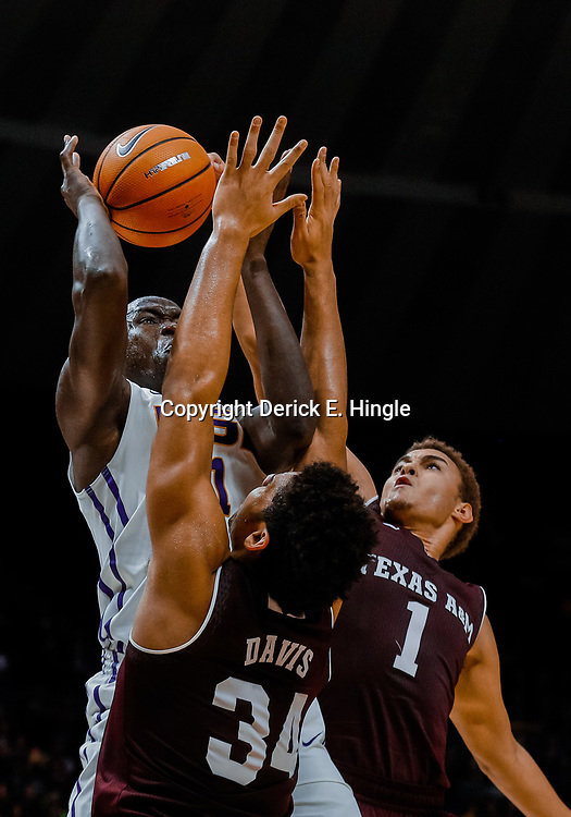 Jan 23, 2018; Baton Rouge, LA, USA; LSU Tigers forward Duop Reath (1) shoots over Texas A&M Aggies center Tyler Davis (34) and forward DJ Hogg (1) during the second half at the Pete Maravich Assembly Center. LSU defeated Texas A&M 77-65. Mandatory Credit: Derick E. Hingle-USA TODAY Sports