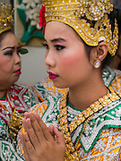 "29 SEPTEMBER 2012 - NAKORN NAYOK, THAILAND:  Thai dancers pray during observances of Ganesh Ustav at Wat Utthayan Ganesh, a temple dedicated to Ganesh in Nakorn Nayok, about three hours from Bangkok. Many Thai Buddhists incorporate Hindu elements, including worship of Ganesh into their spiritual life. Ganesha Chaturthi also known as Vinayaka Chaturthi, is the Hindu festival celebrated on the day of the re-birth of Lord Ganesha, the son of Shiva and Parvati. The festival, also known as Ganeshotsav (""festival of Ganesha"") is observed in the Hindu calendar month of Bhaadrapada, starting on the the fourth day of the waxing moon. The festival lasts for 10 days, ending on the fourteenth day of the waxing moon. Outside India, it is celebrated widely in Nepal and by Hindus in the United States, Canada, Mauritius, Singapore, Thailand, Cambodia, Burma , Fiji and Trinidad & Tobago.     PHOTO BY JACK KURTZ"