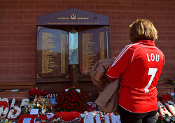 LIVERPOOL, ENGLAND - Saturday, April 14, 2018: A Liverpool supporter pays her respects at the Hillsborough memorial eternal flame before the FA Premier League match between Liverpool FC and AFC Bournemouth at Anfield. (Pic by Laura Malkin/Propaganda)