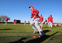 Mike Trout of the Anaheim Angles warms up during an MLB Spring Training workout in on February, 23, 2013 in Tempe, AZ.