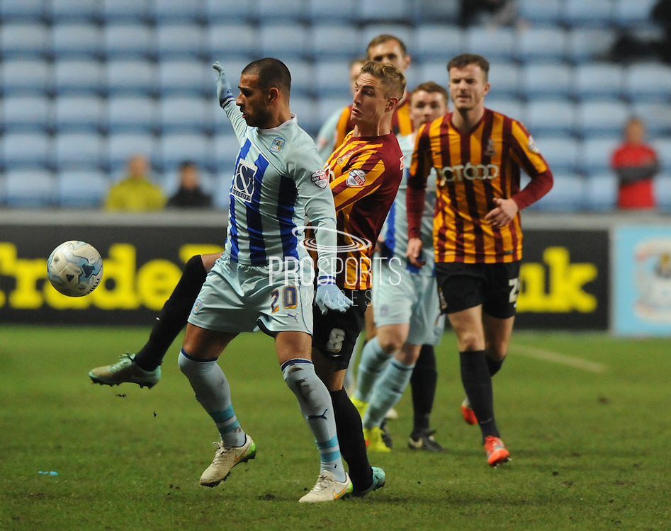 Marcus Tudgay shields the ball from Gary Liddle during the Sky Bet League 1 match between Coventry City and Bradford City at the Ricoh Arena, Coventry, England on 10 March 2015. Photo by Simon Kimber.