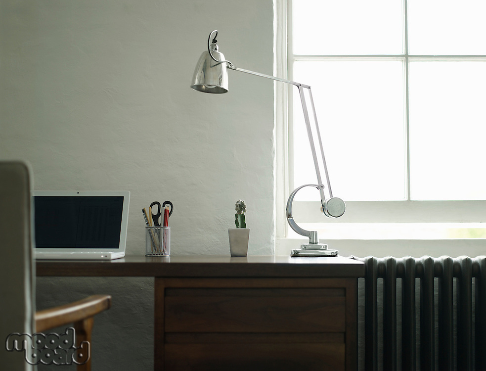 Desk with laptop and lamp