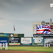 The Everett Aquasox players stand during the national anthems before the game at Everett Memorial Stadium against the Vancouver Canadians.