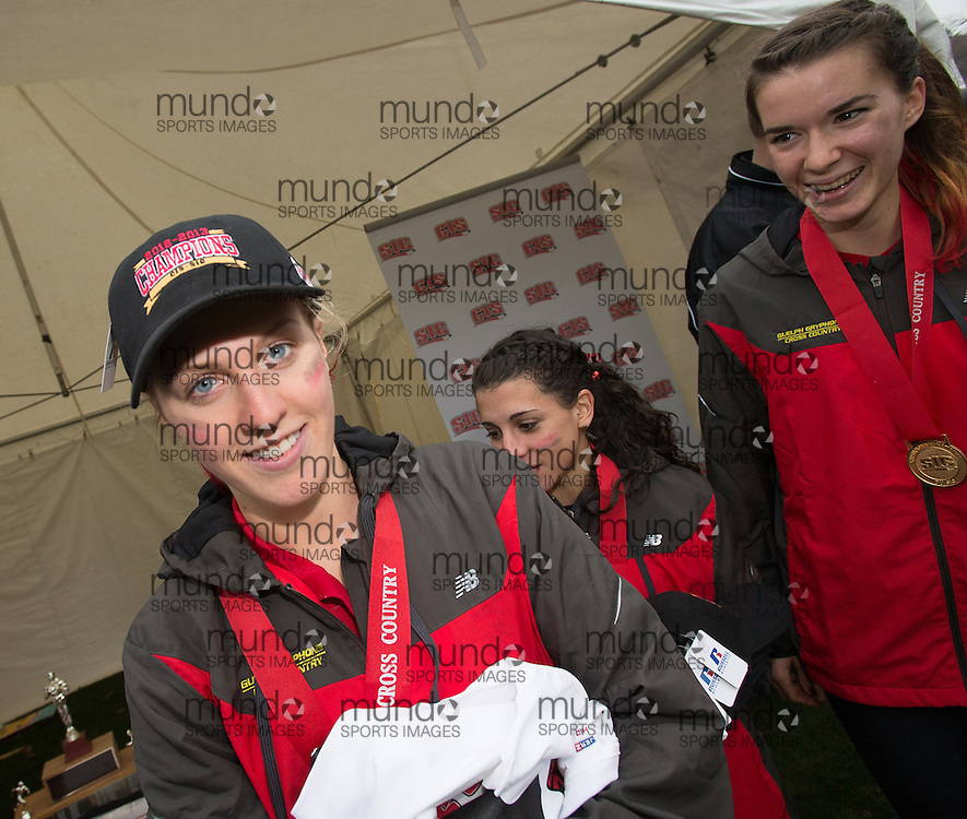 London, Ontario ---2012-11-10--- The Guelph Gryphons women's team receive their championship hats and shirts following their victory at the 2012 CIS Cross Country Championships at Thames Valley Golf Course in London, Ontario, November 10, 2012. .GEOFF ROBINS Mundo Sport Images