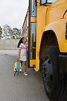 Elementary Student Getting onto School Bus