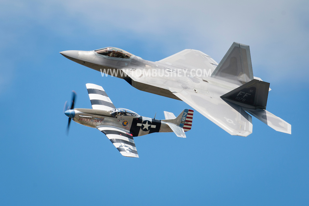 New Windsor, New York - A U.S. Air Force F-22 Raptor and a World War II P-51D Mustang fly on the USAF Heritage Flight during a practice session for the New York Air Show at Stewart International Airport on Aug. 28, 2015. ©Tom Bushey / The Image Works